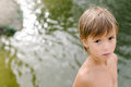 Little boy near water at the beach on hot summer day Royalty Free Stock Photo