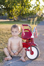 Little boy next to bicycle Stock Photography
