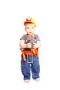 Little boy in an orange helmet with tools on a white background Royalty Free Stock Photography