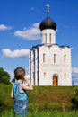 Little boy on a  orthodox church background Stock Photos