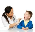 Little boy at paediatrician checking throat Royalty Free Stock Images