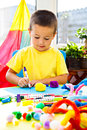 Little boy painting with soft tip pen indoors and gluing Royalty Free Stock Photography