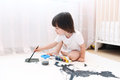 Little boy paints with brush and gouache Royalty Free Stock Photo