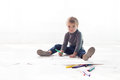 Little boy paints a picture of crayons Royalty Free Stock Photo