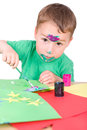 Little boy paints with watercolors painting and tinkering in front of white background Stock Photography