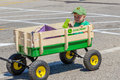 Little boy in a parade you don t need big float to be as this farm shows all he needed is john deere wagon hat and someone strong Royalty Free Stock Images