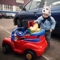 Little boy on parking with shopping carriage Royalty Free Stock Photography