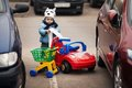 Little boy on parking with shopping carriage Stock Photography