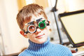Little boy with phoropter at ophthalmology clinic Royalty Free Stock Photo