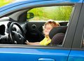 Little boy play big driving playing to be a driver in parents car Stock Photo