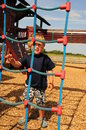 Little boy at playground outdoor near rope ladder Royalty Free Stock Image