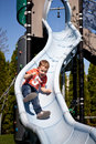 Little boy on the playground slide Stock Photos