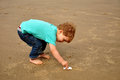 Little boy playing on the beach Royalty Free Stock Photo