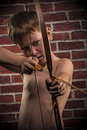 Little boy playing with bow and arrow Royalty Free Stock Photo