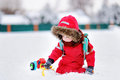 Little boy playing with bright car toy and fresh snow Royalty Free Stock Photo