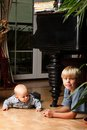 Little boy playing with a brother blond his newborn baby Royalty Free Stock Photo