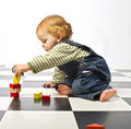 Little boy playing with building blocks Royalty Free Stock Image
