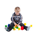 Little boy playing with building blocks isolated Stock Photos