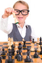 Little boy playing chess with glasses against a white background Stock Image