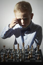Little boy playing chess.Smart Little genius Child. Intelligent game.Chessboard Royalty Free Stock Photo