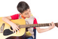Little boy playing classic guitar course on white background