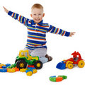 Little boy playing with color toys on floor Royalty Free Stock Image