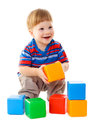 Little boy playing with colorful cubes isolated on white Stock Image