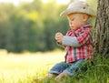 Little Boy Playing Cowboy In N...