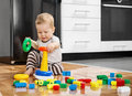 Little boy playing with educational toys on the floor Stock Photos