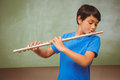 Little boy playing flute in classroom portrait of cute Royalty Free Stock Photos
