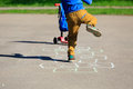 Little boy playing hopscotch on playground Royalty Free Stock Photo
