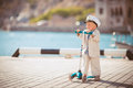 Little boy playing outdoor on the pier beach at a bright sunny day in summer Royalty Free Stock Photo