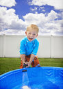 Little Boy playing outside in the Summer Stock Images