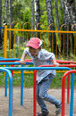 Little boy playing in the playground Royalty Free Stock Photo