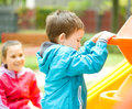 Little boy is playing on playground Royalty Free Stock Photo