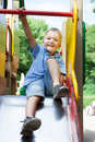 Little boy playing on a playground happy smiling in the park Royalty Free Stock Photos
