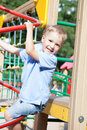Little boy playing on a playground happy smiling in the park Stock Photo
