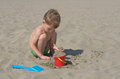Little boy playing with sand Royalty Free Stock Photo