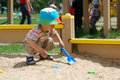 Little boy playing in sandbox Stock Photos