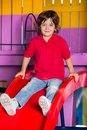 Little boy playing on slide in kindergarten portrait of cute Royalty Free Stock Photos