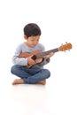 Little boy playing the ukulele Royalty Free Stock Photo