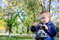 Little boy playing with a vintage camera Stock Photography