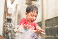 Little boy playing water splash over face Royalty Free Stock Photo