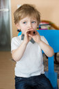 Little boy playing wooden flute indoor adorable Stock Photos