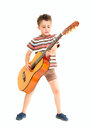 Little boy plays acoustic guitar Royalty Free Stock Photo