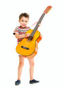 Little boy plays acoustic guitar Royalty Free Stock Photos