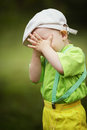 Little boy plays hide and seek funny Royalty Free Stock Image