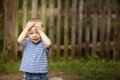 Little boy plays hide and seek funny Royalty Free Stock Images