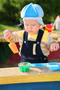 Little boy plays in sandbox Royalty Free Stock Photo