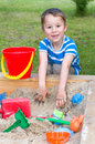 Little boy plays in a sandbox playing the with sand toys Royalty Free Stock Image